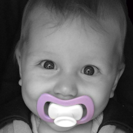 babygirl is very happy with her purple iiamo pacifier