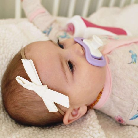 sweet babygirl with her iiamo peace soother in purple
