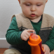 toddler with his iiamo drinking bottle and iiamo flow teat